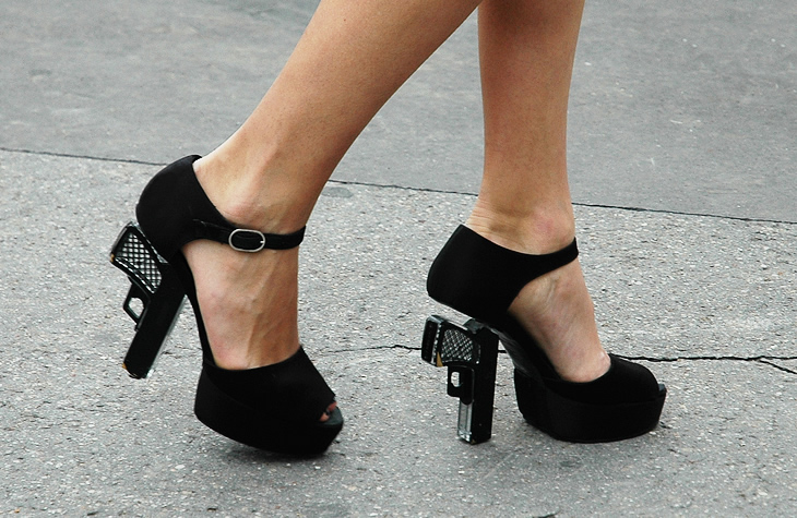 chanelpistolheels Moron tries to get through airport security with gun shaped heels